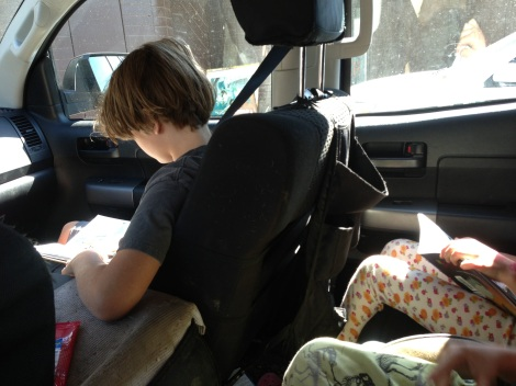 Unschooling Looks Like This Reading in the Car